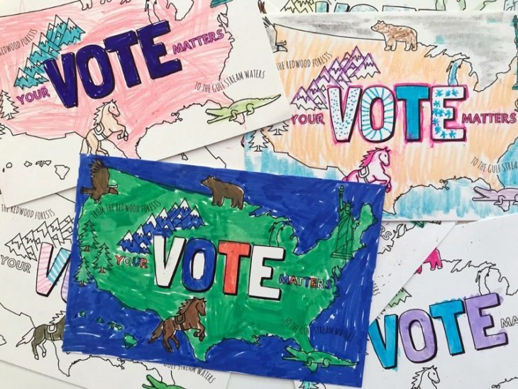 A bunch of postcards with an outline of America and the word VOTE filled in with marker